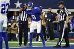 New York Giants quarterback Daniel Jones (8) attempts to walk off the field after suffering an unknown injury running the ball in the first half of an NFL football game against the Dallas Cowboys in Arlington, Texas, Sunday, Oct. 10, 2021. (AP Photo/Michael Ainsworth)