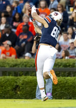 Auburn tight end Sal Cannella (80) grabs touchdown pass from Auburn quarterback Jarrett Stidham (8) against Liberty during the first half of an NCAA college football game, Saturday, Nov. 17, 2018, in Auburn, Ala. (AP Photo/Vasha Hunt)