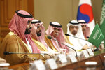 Saudi Crown Prince Mohammed bin Salman, left, speaks with South Korean President Moon Jae-in, not pictured, at the presidential Blue House, Wednesday, June 26, 2019, in Seoul, South Korea. Bin Salman is visiting South Korea for two days - the first time by an heir to the throne of Saudi Arabia since 1998. (Chung Sung-Jun/Pool Photo via AP)