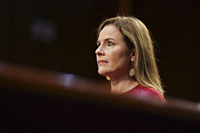 Supreme Court nominee Amy Coney Barrett listens during a confirmation hearing before the Senate Judiciary Committee, Tuesday, Oct. 13, 2020, on Capitol Hill in Washington. (Stefani Reynolds/Pool via AP)