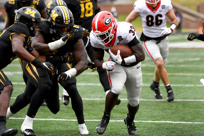 Georgia running back Daijun Edwards (33) scores during the second half of an NCAA college football game against Missouri Saturday, Dec. 12, 2020, in Columbia, Mo. Georgia won 49-14. (AP Photo/L.G. Patterson)