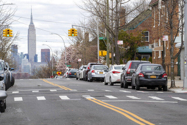 The Empire State building is seen in the distance from an empty street, Thursday, April 2, 2020, in the Brooklyn borough of New York. The new coronavirus causes mild or moderate symptoms for most people, but for some, especially older adults and people with existing health problems, it can cause more severe illness or death. (AP Photo/Mary Altaffer)