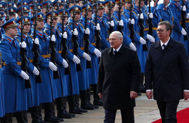 In this photo taken Tuesday, Dec. 3, 2019, Belarus President Alexander Lukashenko, centre, reviews the honor guard with Serbian President Aleksandar Vucic upon his arrival at the Serbia Palace in Belgrade, Serbia. In a surprise move Thursday Aug. 27, 2020, Serbia has joined the European Union in its rejection of the election results in Belarus that kept the country's longtime leader in power and condemned his crackdown against pro-democracy protesters. (AP Photo/Darko Vojinovic)
