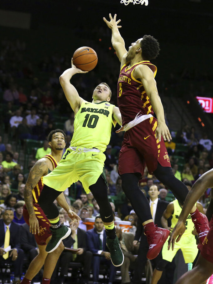 Baylor guard Makai Mason, left, shoots over Iowa State guard Lindell Wigginton during the second half of an NCAA college basketball game Tuesday, Jan. 8, 2019, in Waco, Texas. Baylor won 73-70. (AP Photo/Rod Aydelotte)