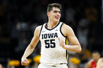 FILE - In this Feb. 20, 2020, file photo, Iowa center Luka Garza celebrates after making a basket during the first half of an NCAA college basketball game against Ohio State in Iowa City, Iowa. Garza was selected to The Associated Press All-America first team, Friday, March 20, 2020. (AP Photo/Charlie Neibergall, File)