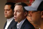 Boston Red Sox Assistant General Managers Brian O'Halloran, center, and Eddie Romero, left, and manager Alex Cora, right, speak with reporters during a news conference at Fenway Park in Boston, Monday, Sept. 30, 2019. (AP Photo/Michael Dwyer)