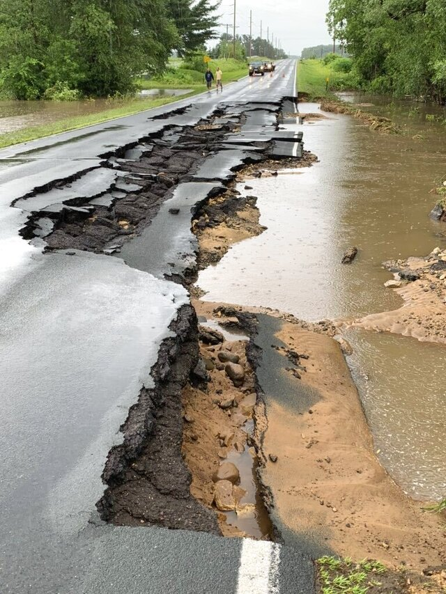 County Highway JJ is washed out by the Kinnickinnic River east of River Falls, Wis., Monday, June 29, 2020. Flash flooding made some roads impassable and forced some residents to evacuate their home in western Wisconsin where up to 6 inches of rain fell by Monday. (Andrew Krueger/Minnesota Public Radio via AP)