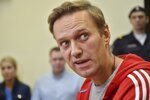 In this photo taken on Wednesday, June 13, 2018, Russian opposition leader Alexei Navalny speaks to journalists in a court room in Moscow, Russia. Navalny has been released from custody after serving a 30-day jail sentence for staging an unsanctioned protest in Moscow. (AP Photo/Dmitry Serebryakov)