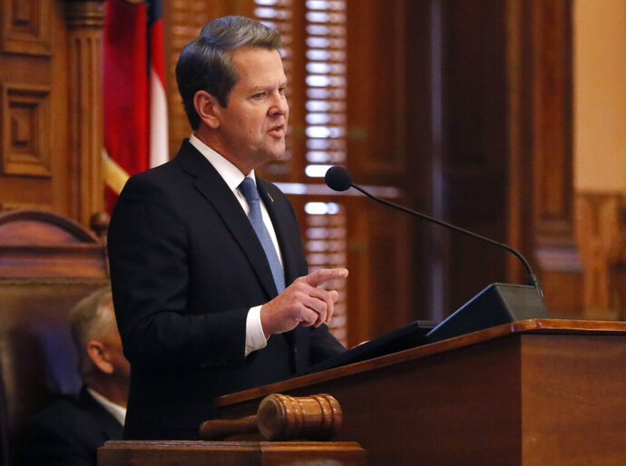 File-This Jan. 17, 2019, file photo shows Georgia Gov. Brian Kemp delivering his first State of the State address, in Atlanta. Kemp could soon have wide leeway in reshaping the state's health care system under a bill given final passage by the state House. The measure, which was approved Monday, March 25, 2019, authorizes Kemp's office to pursue a Medicaid waiver.  It'll give Georgia the flexibility to expand Medicaid more conservatively than federal rules typically allow. The legislation also caps eligibility for any Medicaid expansion to those at or below the federal poverty level, limiting the number of Georgians who could be covered. (Bob Andres/Atlanta Journal-Constitution via AP, File)