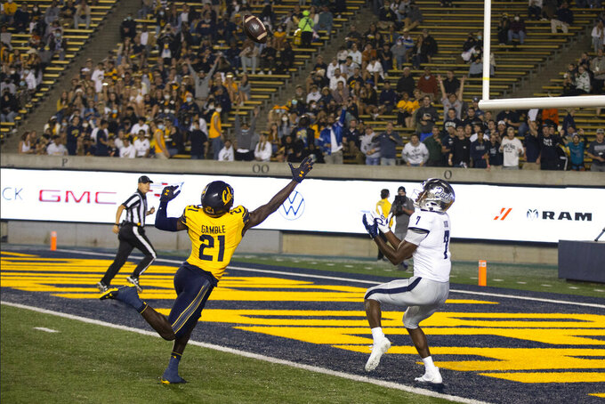Nevada wide receiver Romeo Doubs (7) makes a touchdown reception behind California cornerback Collin Gamble (21) during the second quarter of an NCAA college football game Saturday, Sept. 4, 2021, in Berkeley, Calif. (AP Photo/D. Ross Cameron)