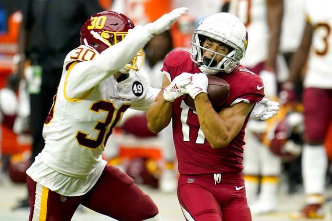 Arizona Cardinals wide receiver Andy Isabella (17) pulls in a pass as Washington Football Team free safety Troy Apke (30) defends during the first half of an NFL football game, Sunday, Sept. 20, 2020, in Glendale, Ariz. (AP Photo/Ross D. Franklin)