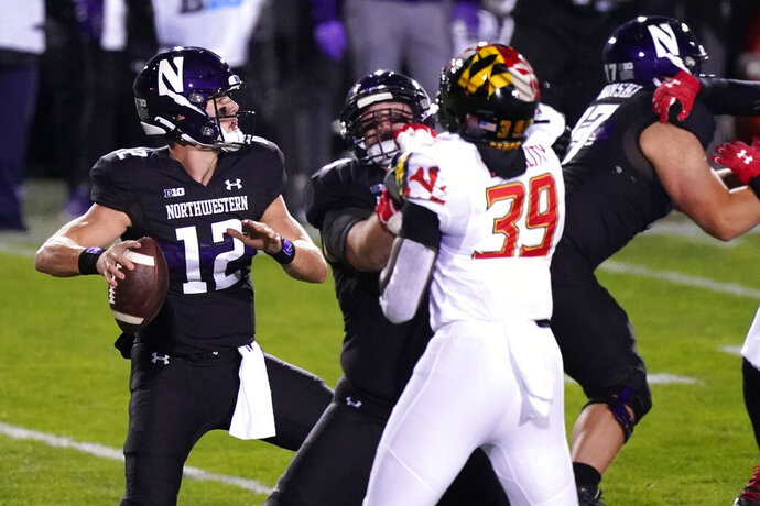 Northwestern quarterback Peyton Ramsey, left, looks to throw a pass against Maryland during the first half of an NCAA college football game in Evanston, Ill., Saturday, Oct. 24, 2020. (AP Photo/Nam Y. Huh)