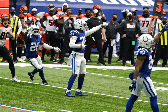 Indianapolis Colts' Julian Blackmon (32) celebrates an interception during the second half of an NFL football game against the Cincinnati Bengals, Sunday, Oct. 18, 2020, in Indianapolis. (AP Photo/Michael Conroy)