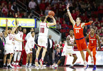 North Carolina State's Braxton Beverly (10) hits the game-winning three-point shot over Clemson's David Skara (24) at the conclusion of an NCAA college basketball game in Raleigh, N.C., Saturday, Jan. 26, 2019. NC State won 69-67. (AP Photo/Ben McKeown)