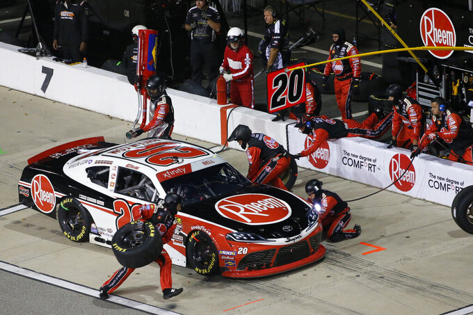 Christopher Bell makes a pit stop during the NASCAR Xfinity Series auto race at Richmond Raceway in Richmond, Va., Friday, Sept. 20, 2019. (AP Photo/Steve Helber)