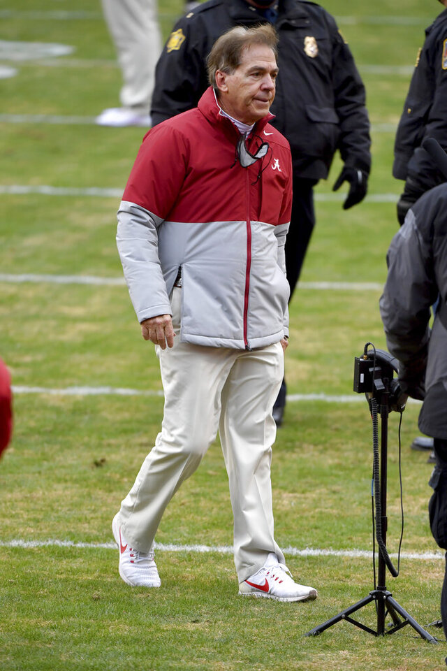 Alabama coach Nick Saban heads off the field following Alabama's 52-3 win over Arkansas in an NCAA college football game Saturday, Dec. 12, 2020, in Fayetteville, Ark. (AP Photo/Michael Woods)
