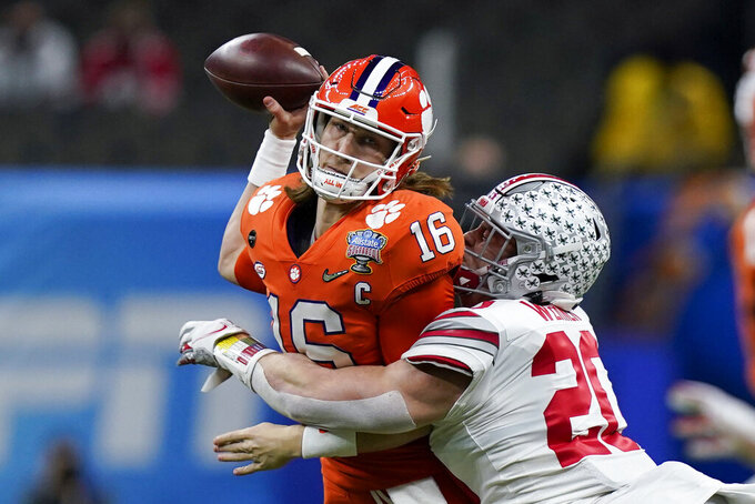 Clemson quarterback Trevor Lawrence passes under pressure by Ohio State linebacker Pete Werner during the first half of the Sugar Bowl NCAA college football game Friday, Jan. 1, 2021, in New Orleans. (AP Photo/Gerald Herbert)