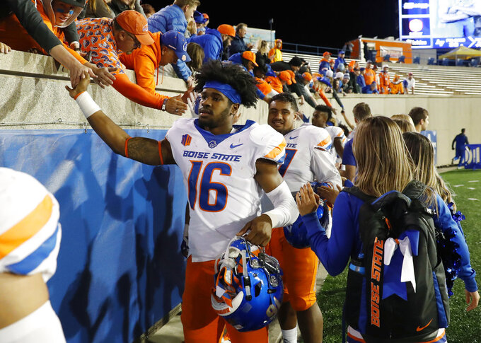 Fans congratulates Boise State Broncos wide receiver John Hightower  (16) after an NCAA college football game against Air Force, Saturday, Oct. 27, 2018, at Air Force Academy, Colo. (AP Photo/David Zalubowski)