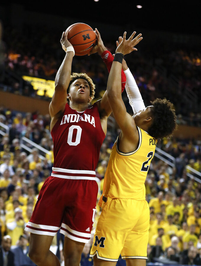 Indiana guard Romeo Langford (0) shoots on Michigan guard Jordan Poole (2) in the first half of an NCAA college basketball game in Ann Arbor, Mich., Sunday, Jan. 6, 2019. (AP Photo/Paul Sancya)