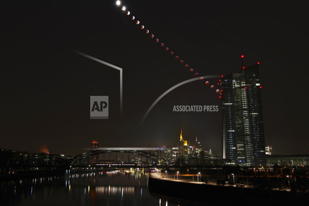 Germany, Frankfurt on Main, composite sequence of total lunar with European Central Bank