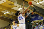 UCLA forward Jalen Hill (24) tries to stop Michigan State forward Xavier Tillman (23) from shooting during the first half of an NCAA college basketball game Wednesday, Nov. 27, 2019, in Lahaina, Hawaii. (AP Photo/Marco Garcia)
