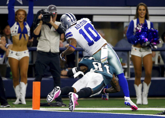 Dallas Cowboys wide receiver Tavon Austin (10) reaches the end zone over Philadelphia Eagles' Jalen Mills (31) for a touchdown in the first half of an NFL football game in Arlington, Texas, Sunday, Oct. 20, 2019. (AP Photo/Ron Jenkins)