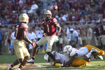 Florida State's James Blackman, center, under pressure from Louisiana-Monroe, dumps an outlet pass to Cam Akers in the second quarter of an NCAA college football game Saturday, Sept. 7, 2019, in Tallahassee Fla. (AP Photo/Steve Cannon)