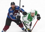 Dallas Stars' Corey Perry (10) and Colorado Avalanche's Ian Cole (28) look for the loose puck during the third period of an NHL Western Conference Stanley Cup playoff game, Monday, Aug. 31, 2020, in Edmonton, Alberta. (Jason Franson/The Canadian Press via AP)