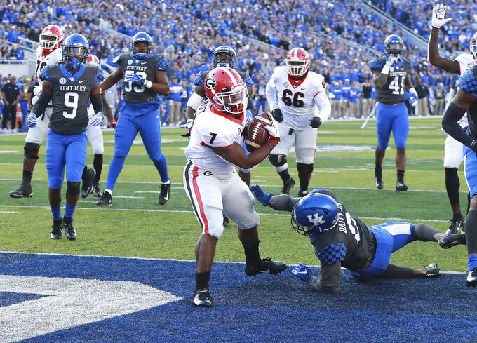 Georgia tailback D'Andre Swift breaks a run for a touchdown against Kentucky during the second quarter in a NCAA college football game Saturday, Nov. 3, 2018, in Lexington, Ky. (Curtis Compton/Atlanta Journal-Constitution via AP)