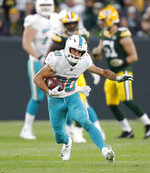 FILE - In this Nov. 11, 2018, file photo, Miami Dolphins' Danny Amendola runs after a catch during the first half of an NFL football game against the Green Bay Packers, in Green Bay, Wis. The Detroit Lions signed Danny Amendola, giving them a slot receiver they missed after trading Golden Tate to Philadelphia last season. Detroit made the move Monday, March 11, 2019, to add another former New England Patriot to the organization.  Amendola had 59 receptions for 575 yards and one touchdown last season with the Miami Dolphins after playing for New England from 2013-17 and winning two Super Bowls. (AP Photo/Matt Ludtke, File)