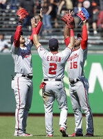 Washington Nationals' Juan Soto, left, celebrates with Adam Eaton and Victor Robles, right, after the Nationals defeated the San Francisco Giants 4-1 in a baseball game in San Francisco, Wednesday, Aug. 7, 2019. (AP Photo/Jeff Chiu)