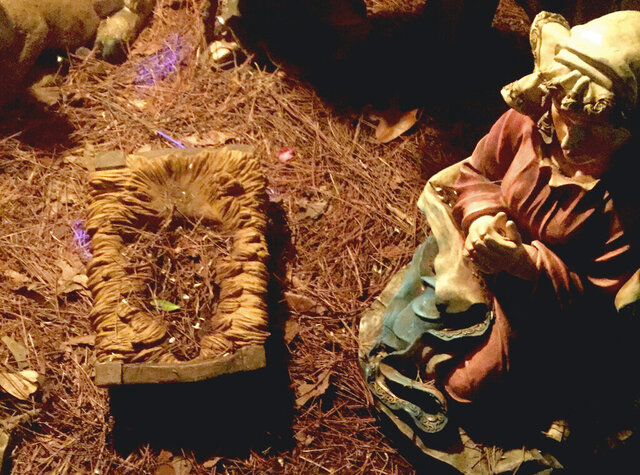 This Monday, Dec. 30, 2019, photo shows an empty crib at the display at Dorothy B. Oven Park in Tallahassee, Fla. On the sixth day of Christmas, Baby Jesus vanished from his manger in a popular nativity scene at the Florida park, right under the noses of Mary, Joseph and bowing kings. The park each year hosts a well-trafficked and colorful Christmas display. (Jeff Takacs via AP)