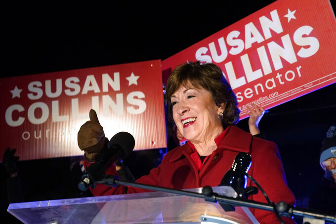 FILE - In this Nov. 4, 2020, file photo, Sen. Susan Collins, R-Maine, gives a thumbs-up as she addresses supporters just after midnight in Bangor, Maine. Collins won a tough reelection fight in a campaign that featured astonishing levels of spending. (AP Photo/Robert F. Bukaty, File)