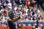 Chicago Bears quarterback Justin Fields throws during the first half of an NFL preseason football game against the Miami Dolphins in Chicago, Saturday, Aug. 14, 2021. (AP Photo/Nam Y. Huh)
