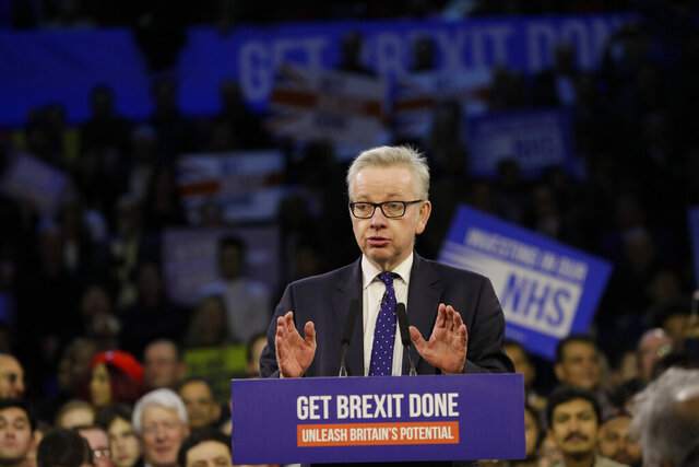FILE - In this Wednesday, Dec. 11, 2019 file photo, Britain's Chancellor of the Duchy of Lancaster Michael Gove speaks at the Conservative Party's final election campaign rally at the Copper Box Arena in London. Britain goes to the polls on Dec. 12. The British government insisted Monday April 27, 2020 that it won't extend the deadline for striking a post-Brexit deal with the European Union, despite the upheaval caused by the coronavirus. (AP Photo/Kirsty Wigglesworth, File)