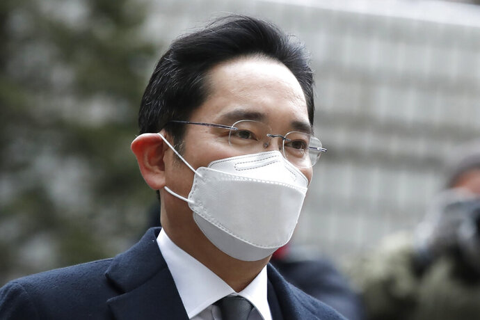 Samsung Electronics Vice Chairman Lee Jae-yong arrives at the Seoul High Court in Seoul, South Korea, Monday, Jan. 18, 2021. Samsung scion Lee will not appeal a court ruling that sentenced him to two and a half years in prison for bribing South Korea's then-president for business favors. (AP Photo/Lee Jin-man)