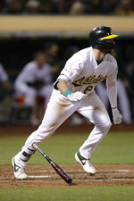 Oakland Athletics' Seth Brown drops his bat after hitting an RBI double off Kansas City Royals' Jorge Lopez during the seventh inning of a baseball game Tuesday, Sept. 17, 2019, in Oakland, Calif. (AP Photo/Ben Margot)