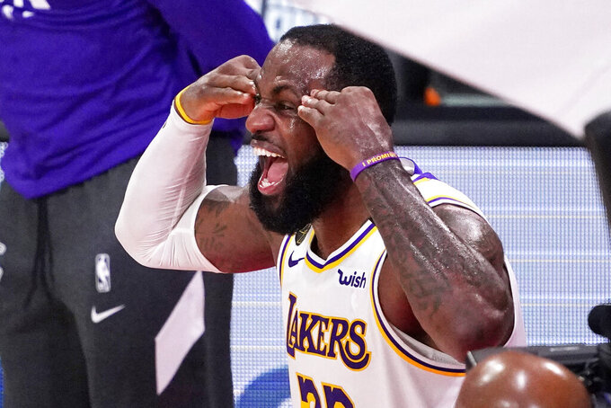 Los Angeles Lakers' LeBron James (23) celebrates after the Lakers defeated the Miami Heat 103-88 in Game 6 of basketball's NBA Finals Sunday, Oct. 11, 2020, in Lake Buena Vista, Fla. (AP Photo/Mark J. Terrill)