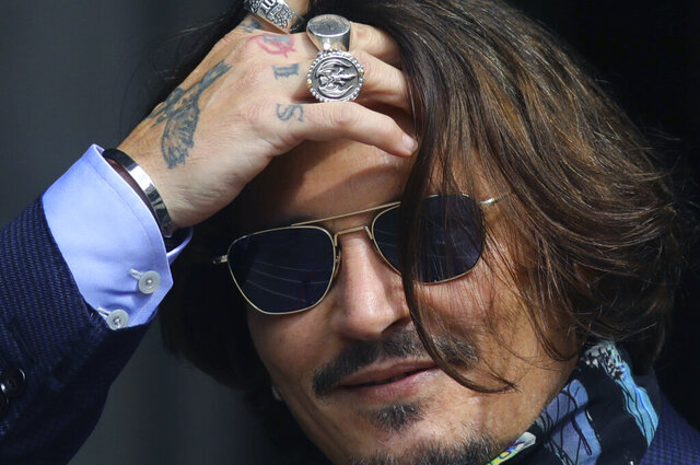 Actor Johnny Depp arrives at the High Court for a hearing in his libel case, in London, Friday,  July 24, 2020. Depp is suing News Group Newspapers, publisher of The Sun, and the paper's executive editor, Dan Wootton, over an April 2018 article that called him a