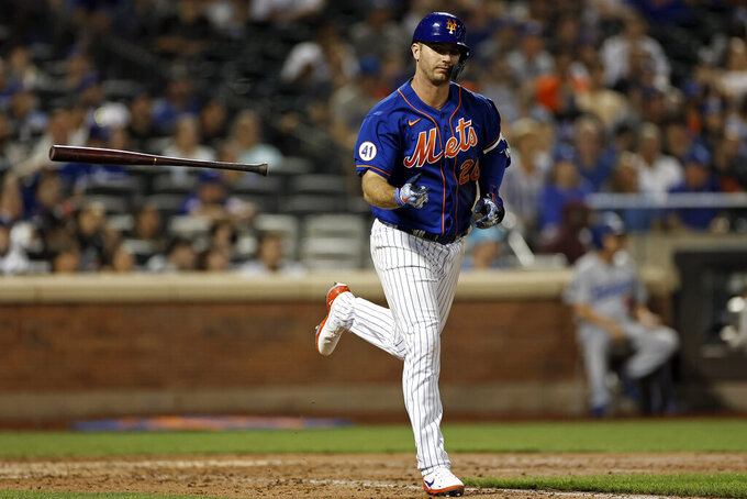 New York Mets' Pete Alonso throws his bat after flying out during the seventh inning of a baseball game against the Los Angeles Dodgers on Sunday, Aug. 15, 2021, in New York. (AP Photo/Adam Hunger)