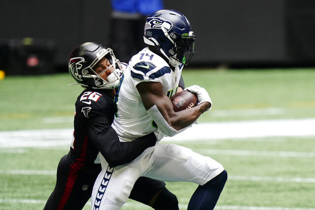 Atlanta Falcons cornerback Isaiah Oliver (26) tackles Seattle Seahawks wide receiver DK Metcalf (14) during the first half of an NFL football game, Sunday, Sept. 13, 2020, in Atlanta. (AP Photo/Brynn Anderson)