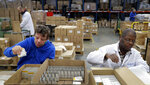 """FILE - In this Thursday, Jan. 17, 2019 file photo, David Wright, left, and Dan During, right, pack bars of soap at the Clarity-The Soap Co. premises in London. The U.K. election result means Britain's departure from the European Union will almost certainly happen - after multiple delays - on Jan. 31, as scheduled. But for companies that have had to plan for all sorts of potentially chaotic outcomes to Brexit, even just a little clarity is a breath of fresh air. """"The idea that the situation with Brexit is going to be resolved is good for business,"""" said Andy Zneimer, who handles communications for a small soap business in east London called Clarity-The Soap Co. (AP Photo/Kirsty Wigglesworth)"""