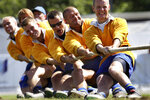 FILE - In this July 14, 2005, file photo, Team Sweden pulls during the men Tug of War competition at the World Games in Duisburg, Germany. Joining the array of postponed events in the midst of the coronavirus pandemic, officials announced Thursday that the 11th edition of the World Games in Birmingham, Alabama will now be held in the summer of 2022. (AP Photo/Michael Sohn, File)