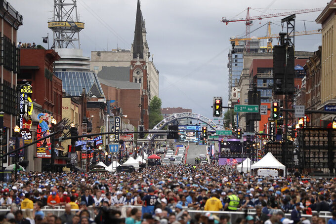 Fans watch the main stage ahead of the first round at the NFL football draft, Thursday, April 25, 2019, in Nashville, Tenn. (AP Photo/Mark Humphrey)