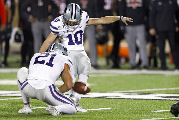 Kansas State's Blake Lynch (10) kicks a field goal during the first half of an NCAA college football game Saturday, Nov. 23, 2019, in Lubbock, Texas. (Brad Tollefson/Lubbock Avalanche-Journal via AP)