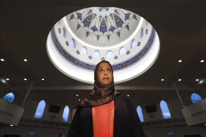 In this Monday, June 22, 2020, photo, Hind Makki, poses for a portrait at the The Prayer Center of Orland Park in Orland Park, Ill. Makki remembers how, as a young girl, she would call out others at the Islamic school she attended when she heard an Arabic word that means