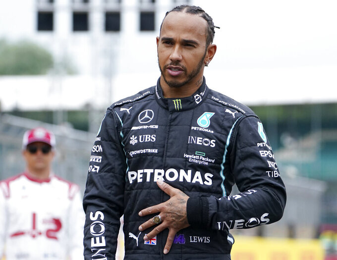 """Mercedes driver Lewis Hamilton of Britain looks out during """"F1 One Begins"""" event at the Silverstone circuit, Silverstone, England, Thursday, July 15, 2021. The British Formula One Grand Prix will be held on Sunday. (AP Photo/Jon Super)"""