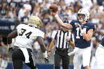 Penn State quarterback Sean Clifford (14) passes over Idaho linebacker Leo Tamba (34) during the 2nd quarter of an NCAA college football game in State College, Pa., on Saturday, Aug. 31, 2019. (AP Photo/Barry Reeger)
