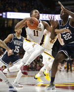 Minnesota guard Isaiah Washington (11) drives to the basket against Mount St. Mary's forward Nana Opoku (22) during the first half of an NCAA basketball game Sunday, Dec. 30, 2018, in Minneapolis. (AP Photo/Paul Battaglia)