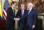 Venezuela's self-proclaimed interim president Juan Guaido, left, shakes with Vice President Mike Pence, after a meeting of the Lima Group concerning Venezuela at the Foreign Ministry in Bogota, Colombia, Monday, Feb. 25, 2019. Pence's appearance before the Lima Group comes two days after a U.S.-backed effort to deliver humanitarian across the border from Colombia ended in violence. Pictured in the center is Colombia's President Ivan Duque. (AP Photo/Martin Mejia)